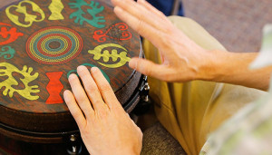 Person drumming with their hands