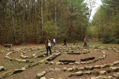 rock circle with people walking through