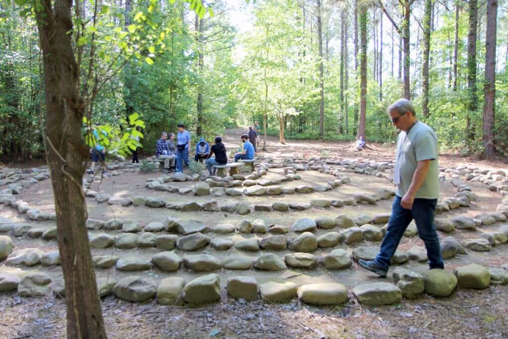 Alumni, families and staff share a mindfulness experience at the labyrinth