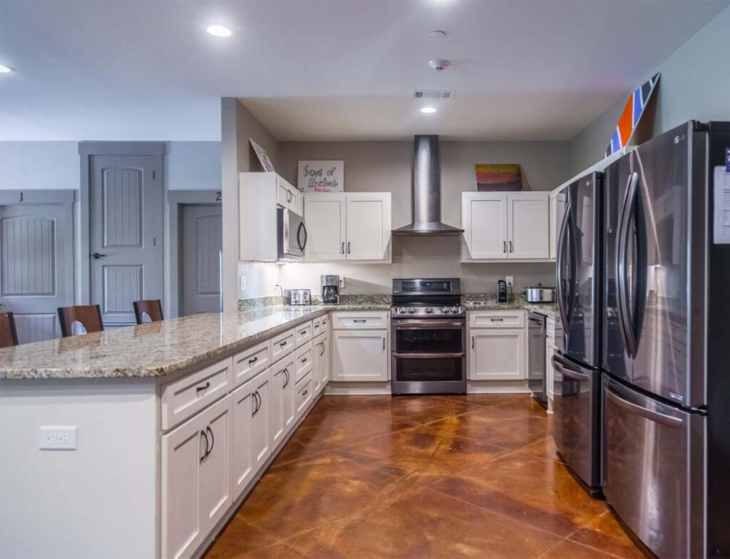 Nutrition and dietetics classes take place in the kitchens of transitional homes adjacent to the Oxford Outpatient Center. Each house has a large kitchen and dining room where patients cook and eat together.
