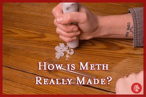 Hand crushing ingredients in the process of making meth